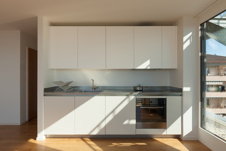 kitchen cabinet: Interior of nice apartment, white domestic kitchen