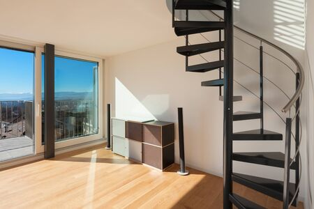 Inter, Wendeltreppe eines modernen Loft