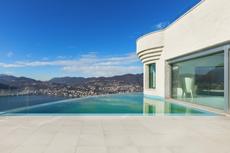 beautiful modern house with infinity pool, exterior 스톡 콘텐츠