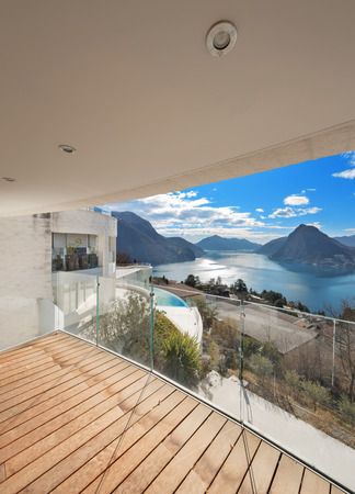 balcony: balcony of a modern penthouse, beautiful panoramic view