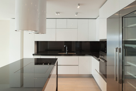 Interior of wide room with kitchen modern design