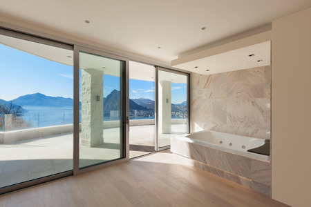 Interior of wide room with marble bathroom modern design Banco de Imagens