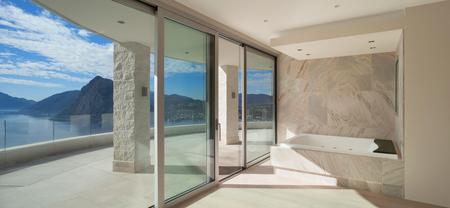 white door: Interior of wide room with marble bathroom modern design Stock Photo
