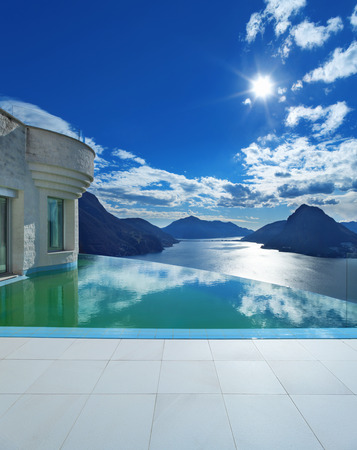 nobody real: beautiful landscape from a modern house with infinity pool