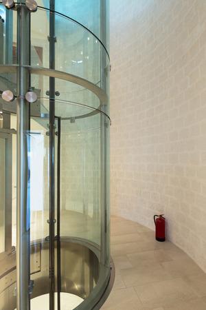 modern building: futuristic elevator in a modern building