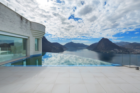 lake house: beautiful landscape from a modern house with infinity pool