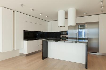 Interior of wide room with kitchen modern design