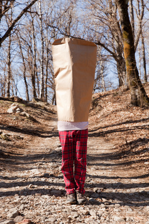 blind child: little girl in the woods with lots covering her head