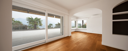 house windows: Interior of modern apartment with wooden floor