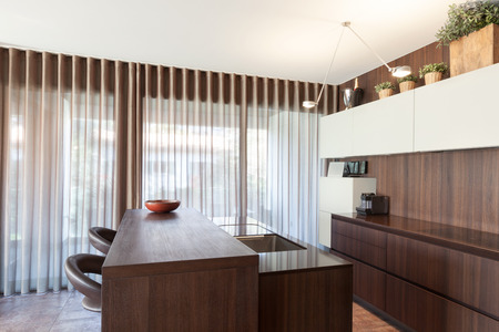 Interiors of new apartment, wooden kitchen modern design Stock Photo