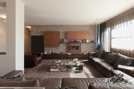 wide open spaces: Interiors of new apartment , living room with leather divans Stock Photo