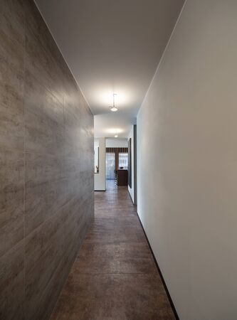 marble wall: Interiors of new apartment, long corridor with marble wall Stock Photo