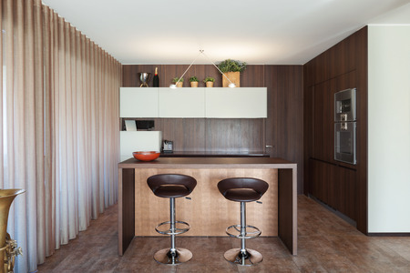 apartment: Interiors of new apartment, wooden kitchen modern design Stock Photo