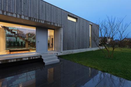 Entrance of a modern house, night scene
