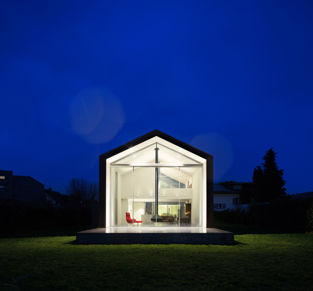 house exterior: Exterior of a modern house, night scene