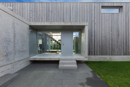 Entrance of a modern house in concrete and wood, exterior