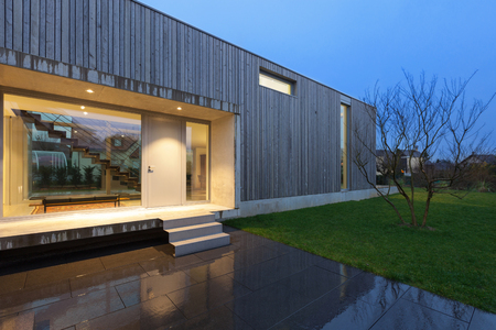 home and garden: Entrance of a beautiful modern house, night scene