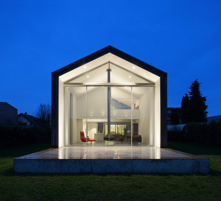wide  wet: beautiful interiors of a modern house, view from exterior