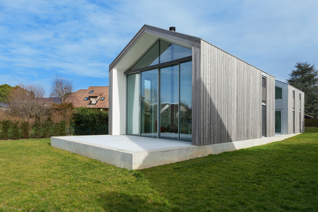 Exterior of a beautiful modern house, view from lawn Foto de archivo