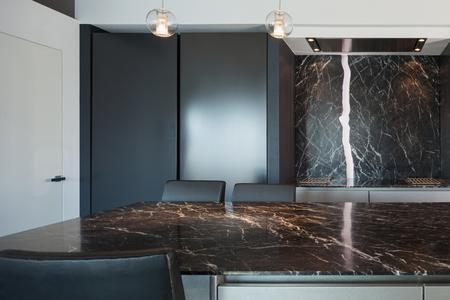 counter top: Interior of a loft, kitchen with marble counter top, modern design
