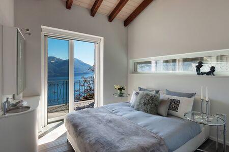 bedroom design: Interior of a loft, comfortable bedroom, modern design Stock Photo