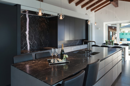 Interior of a loft, kitchen with marble counter top, modern design