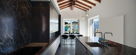 marble wall: Interior of a loft, kitchen with marble counter top, modern design