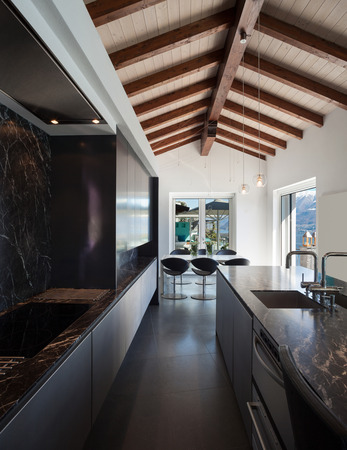 architectures: Interior of a loft, kitchen with marble counter top, modern design