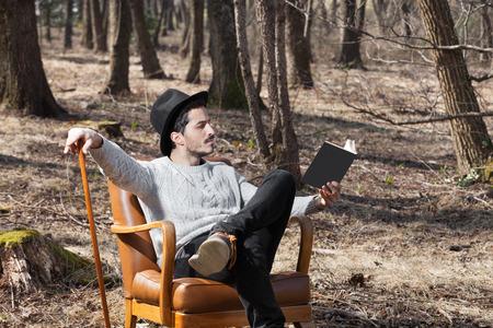 novel: man reading a novel in the woods, portrait