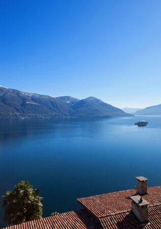 destination scenics: Panoramic view of Lake Maggiore in Ticino, Switzerland