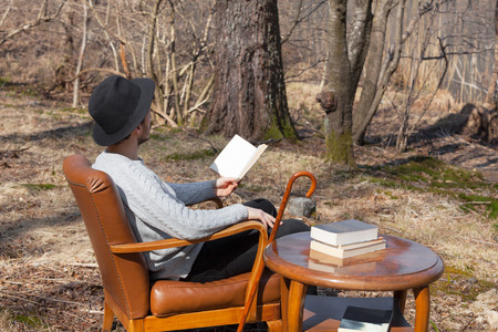 novel: young man reads a novel in the woods, portrait Stock Photo