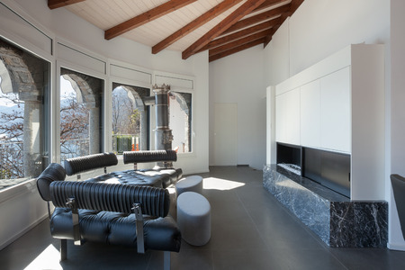 fireplace living room: Interior, living room of a villa, leather divan and fireplace