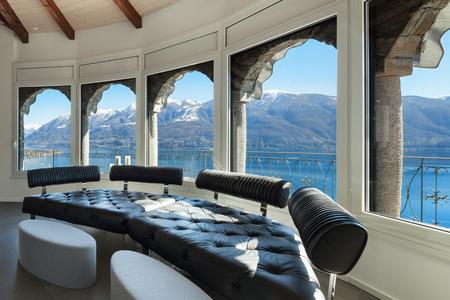 divan: Interior of a loft, wide living room, leather divan Stock Photo