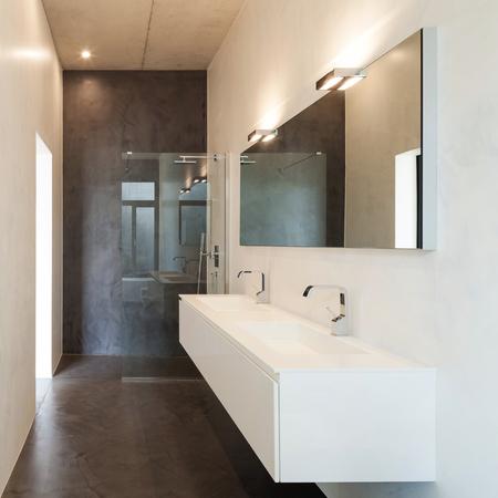 interior of apartment, modern bathroom with sink and shower Standard-Bild