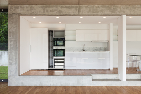 ventana abierta interior: Interior, modern kitchen of concrete apartment, parquet floor