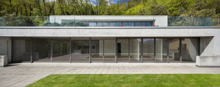 modern architecture: Exterior of facade of a modern house, woodland background