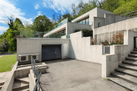 backyard of a concrete building with garage Stock Photo