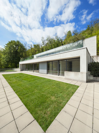 modern home: Exterior modern architecture, concrete house with green lawn