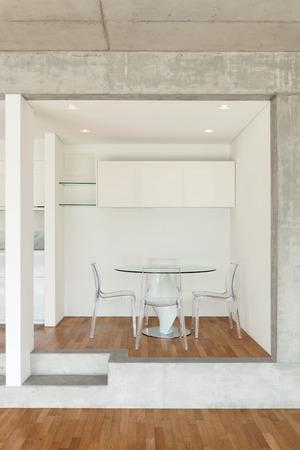 modern chair: Interior of modern kitchen of concrete apartment with parquet floor Stock Photo