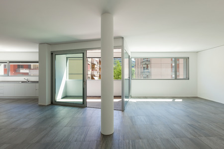 wide open spaces: Interior of empty apartment, wide room with inside terrace Stock Photo