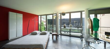 glass bed: Interior of a studio apartment, wide room with glass table and bed