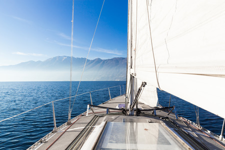 sailboat: Sailing boat in sunny day in the lake