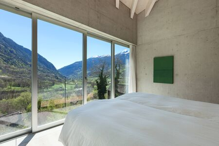 furnished: Interior of a modern loft in cement, bedroom