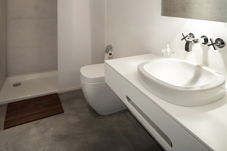 concrete floor: interior of new apartment, modern bathroom with shower Stock Photo