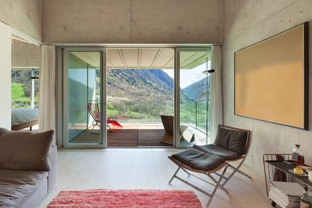 loft living: Interior of a modern loft, living with veranda. concrete walls