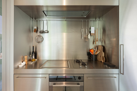 domestic kitchen: Domestic stainless steel kitchen, hob with objects
