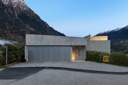 Architecture, entrance of a modern house, evening in mountain