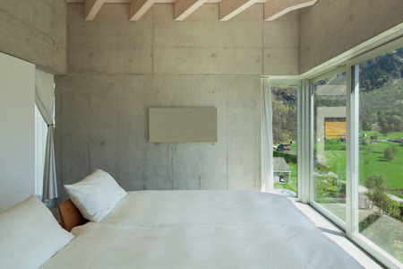 chalets: Interior of a modern chalet in cement, bedroom