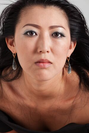 beautiful mature woman: Elegant Asian woman in studio Stock Photo