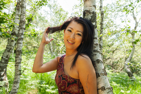 female model: Asian girl portrait outdoors in the woods